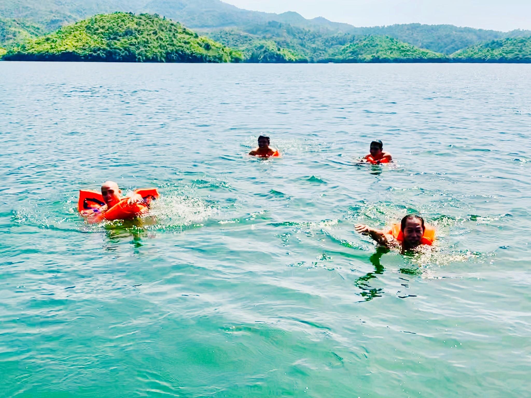 swimming on Ta Dung Lake.jpg